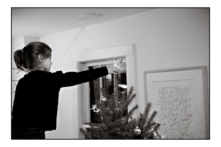 Willa putting the finishing touch to the tree.