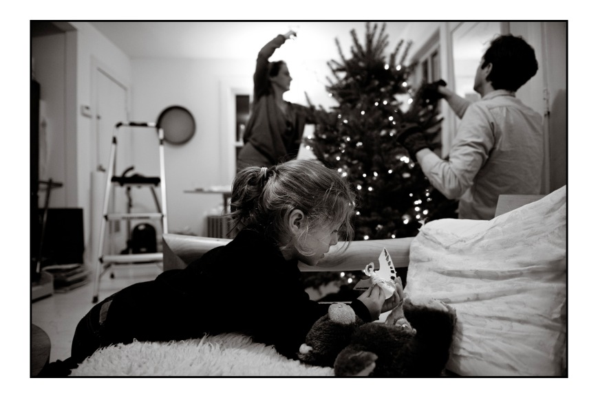 Willa getting the angel ready for the top of the tree.