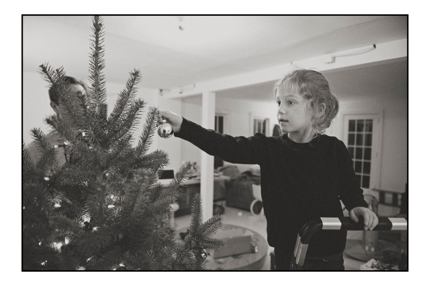 Willa decorating the tree.